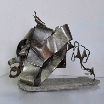 <b>Fold with unique direction</b>, 2018. </br>Recycled stainless steel and Luserna stone. 45 x 42 x 26 cm.