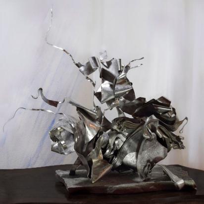 <b>Plica ex plica</b>, 2016.</br> Recycled stainless steel, Luserna stone.  47 x 57 x 33 cm.